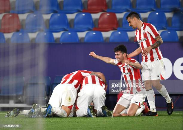 Alex Berenguer of Athletic Club celebrates with teammates after scoring his team's second goal during the Copa del Rey Semi Final Second Leg match...