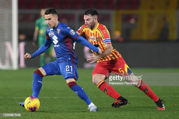 Alex Berenguer of Torino FC vies with Fabio Lucioni of US Lecce during the Serie A match between US Lecce and Torino FC at Stadio Via del Mare on...