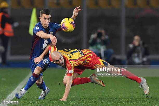 Alex Berenguer of Torino FC vies with Riccardo Saponara of US Lecce during the Serie A match between US Lecce and Torino FC at Stadio Via del Mare on...