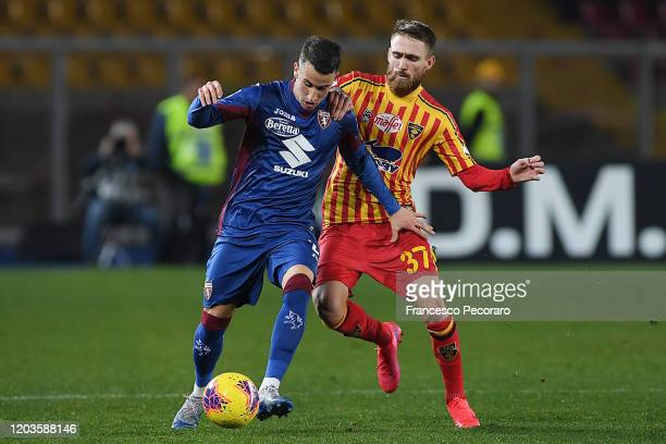 Alex Berenguer of Torino FC vies with Zan Majer of US Lecce during the Serie A match between US Lecce and Torino FC at Stadio Via del Mare on...