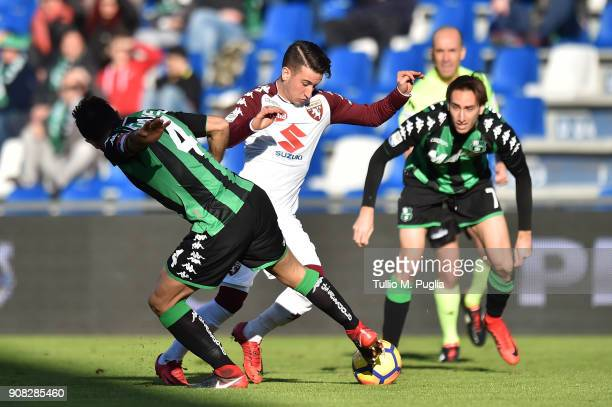Alex Berenguer of Torino is challenged by Alfred Duncan of Sassuolo during the serie A match between US Sassuolo and Torino FC at Mapei Stadium...