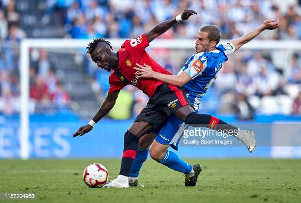 Alex Bergantinos of Deportivo de La Coruna competes for the ball with Lago Junior of RCD Mallorca during the La Liga 123 play off match between...