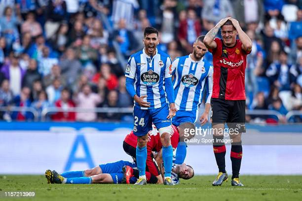 Alex Bergantinos of Deportivo de La Coruna lies injured during the La Liga 123 play off match between Deportivo De La Coruna and RCD Mallorca at...