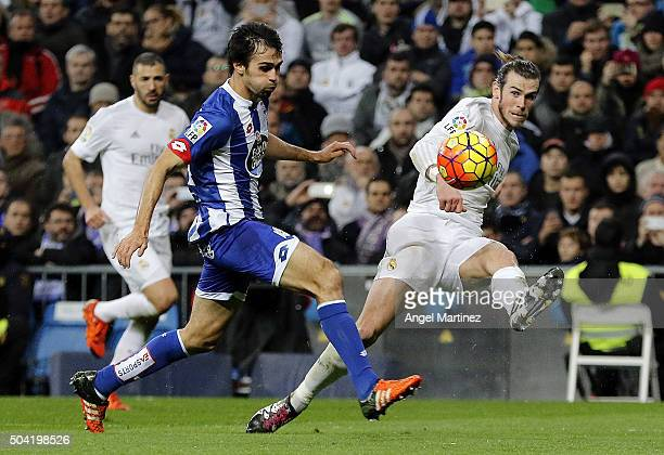 Alex Bergantinos of Real Madrid passes the ball under pressure from Alejandro Arribas of Depotivo La Coruna during the La Liga match between Real...