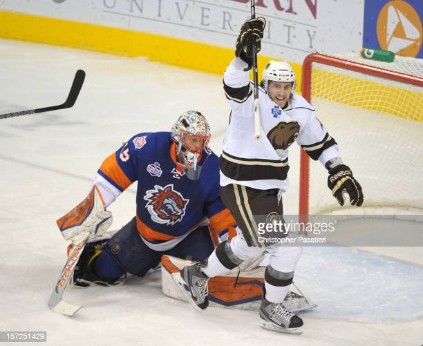 Alex Berry of the Hershey Bears reacts to a goal during an American Hockey League game against the Bridgeport Sound Tigers on November 30, 2012 at...