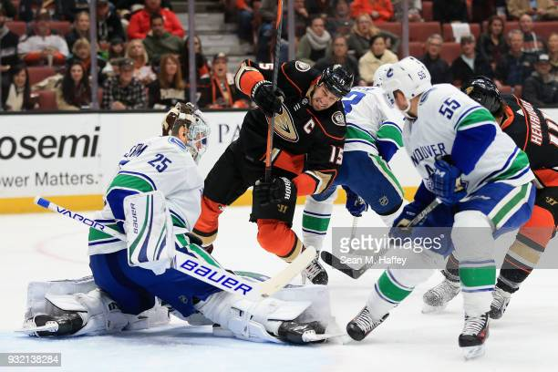Alex Biega and Jacob Markstrom of the Vancouver Canucks defend against Ryan Getzlaf of the Anaheim Ducks during the first period of a game at Honda...