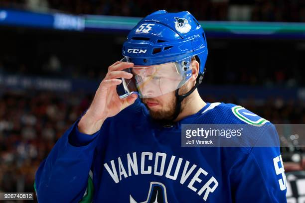 Alex Biega of the Vancouver Canucks adjusts his shield during their NHL game against the Colorado Avalanche at Rogers Arena February 20 2018 in...