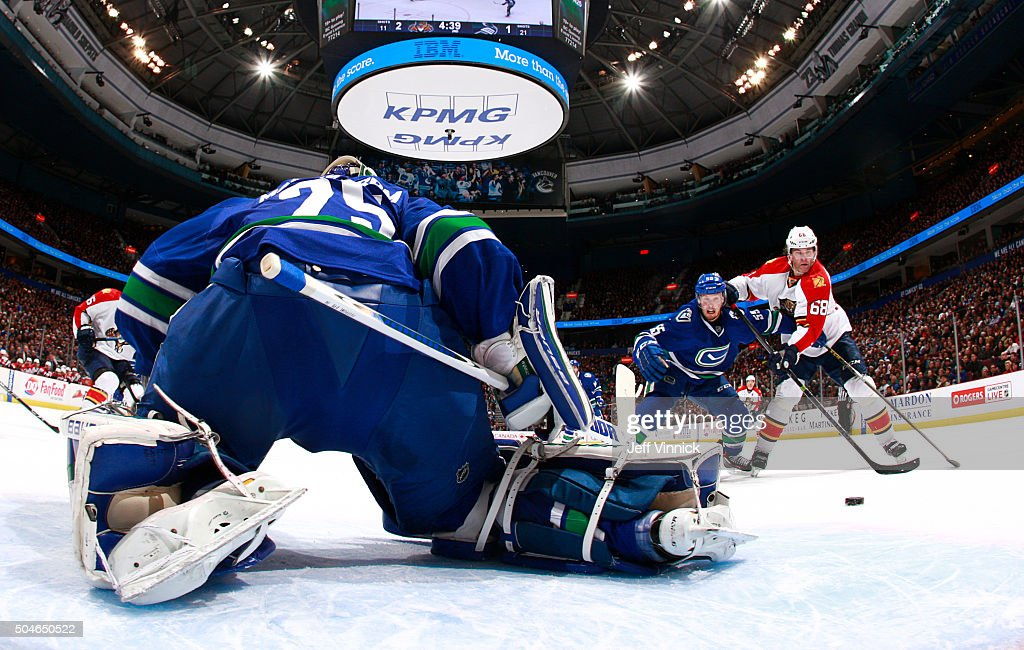 Alex Biega #55 of the Vancouver Canucks and Jaromir Jagr #68 of the Florida Panthers battle for a rebound after Jacob Markstrom #25 of the Vancouver Canucks makes a save during their NHL game against the Florida Panther at Rogers Arena January 11, 2016 in Vancouver, British Columbia, Canada. Vancouver won 3-2.