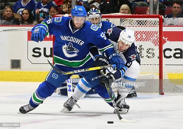 Alex Biega of the Vancouver Canucks edges out Shawn Matthias of the Winnipeg Jets during their NHL game at Rogers Arena December 22 2016 in Vancouver...