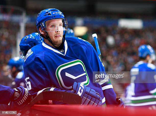 Alex Biega of the Vancouver Canucks looks on from the bench during their NHL game against the Ottawa Senators at Rogers Arena February 25 2016 in...