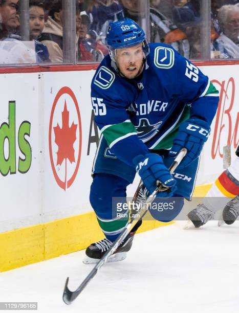 Alex Biega of the Vancouver Canucks skates after the loose puck in NHL action against the Calgary Flames on February 2019 at Rogers Arena in...