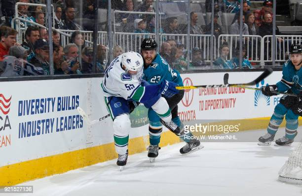 Alex Biega of the Vancouver Canucks skates against Barclay Goodrow of the San Jose Sharks at SAP Center on February 15 2018 in San Jose California