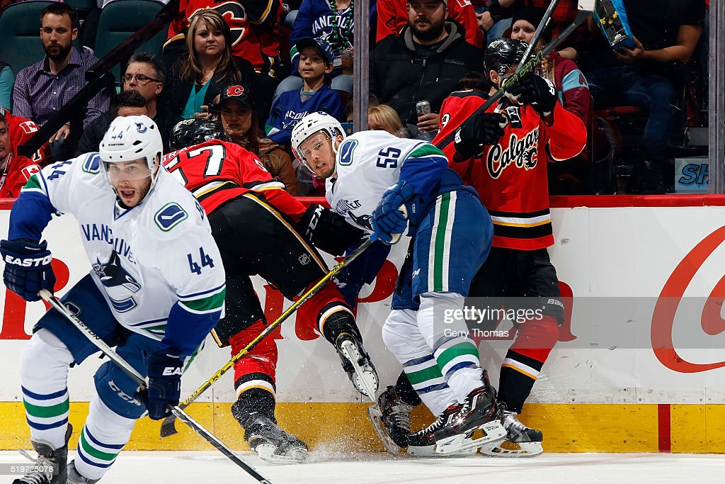 Alex Biega #55 of the Vancouver Canucks skates against the Calgary Flames during an NHL game on April 7, 2016 at the Scotiabank Saddledome in Calgary, Alberta, Canada.