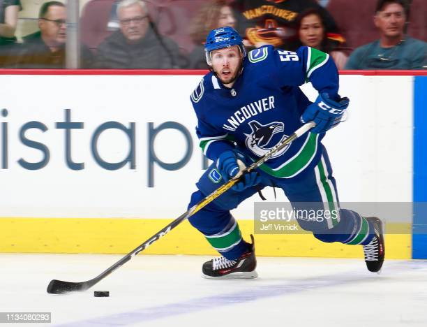 Alex Biega of the Vancouver Canucks skates up ice with the puck during their NHL game against the New York Islanders at Rogers Arena February 23 2019...