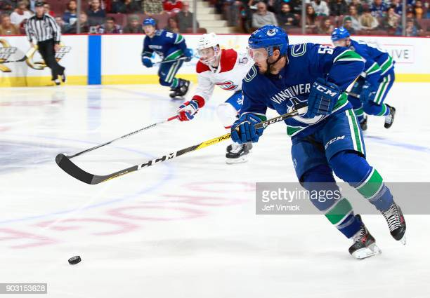 Alex Biega of the Vancouver Canucks skates up ice with the puck during their NHL game against the Montreal Canadiens at Rogers Arena December 19 2017...