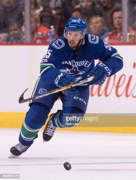 Alex Biega of the Vancouver Canucks skates with the puck during NHL action against the Washington Capitals on October 2017 at Rogers Arena in...