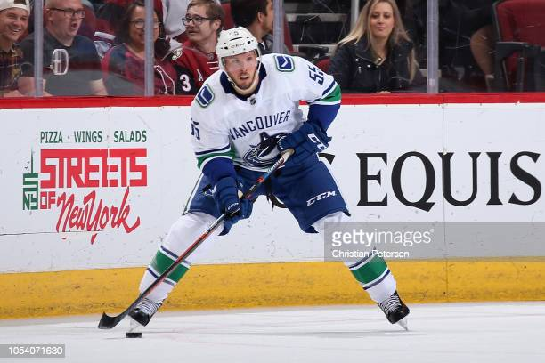 Alex Biega of the Vancouver Canucks skates with the puck during the NHL game against the Arizona Coyotes at Gila River Arena on October 25 2018 in...