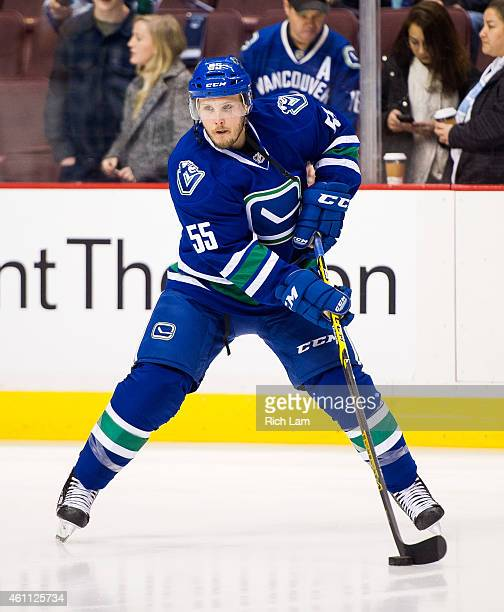 Alex Biega of the Vancouver Canucks skates with the puck during the team warmup prior to NHL action between the Calgary Flames and the Vancouver...