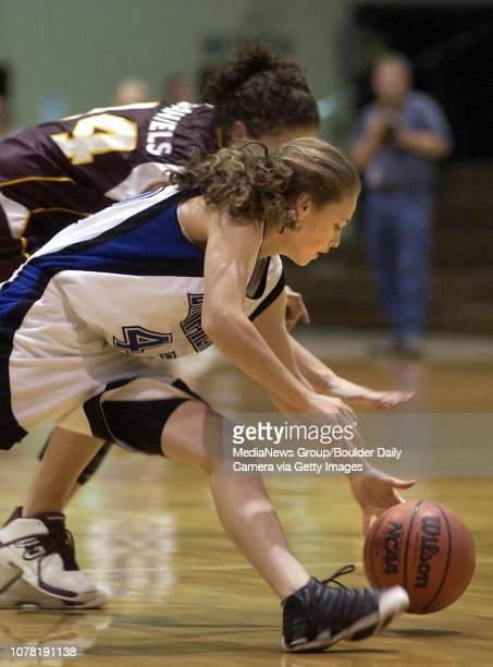 Alex Biegner front Broomfield High School grabs for a loose ball away from Paige Daniels Windsor High School during the sweet 16 state playoff game...