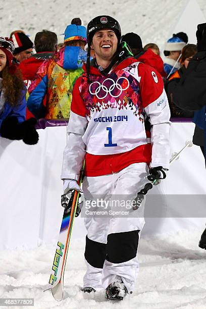 Alex Bilodeau of Canada celebrates winning gold in the Men's Moguls Finals on day three of the Sochi 2014 Winter Olympics at Rosa Khutor Extreme Park...