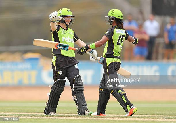 Alex Blackwell and Harmanpreet Kaur of the Thunder celebrate after Kaur hit the winning runs during the Women's Big Bash League match between the...