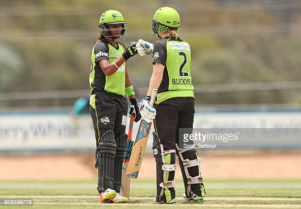 Alex Blackwell and Harmanpreet Kaur of the Thunder celebrate after Kaur hit a six during the Women's Big Bash League match between the Melbourne...