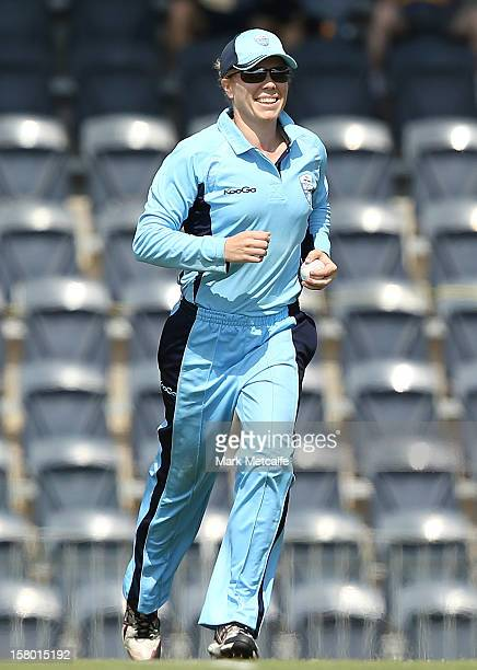 Alex Blackwell celebrates taking a catch to dismiss Carly Ryan of the Roar during the women's Twenty20 match between the New South Wales Breakers and...