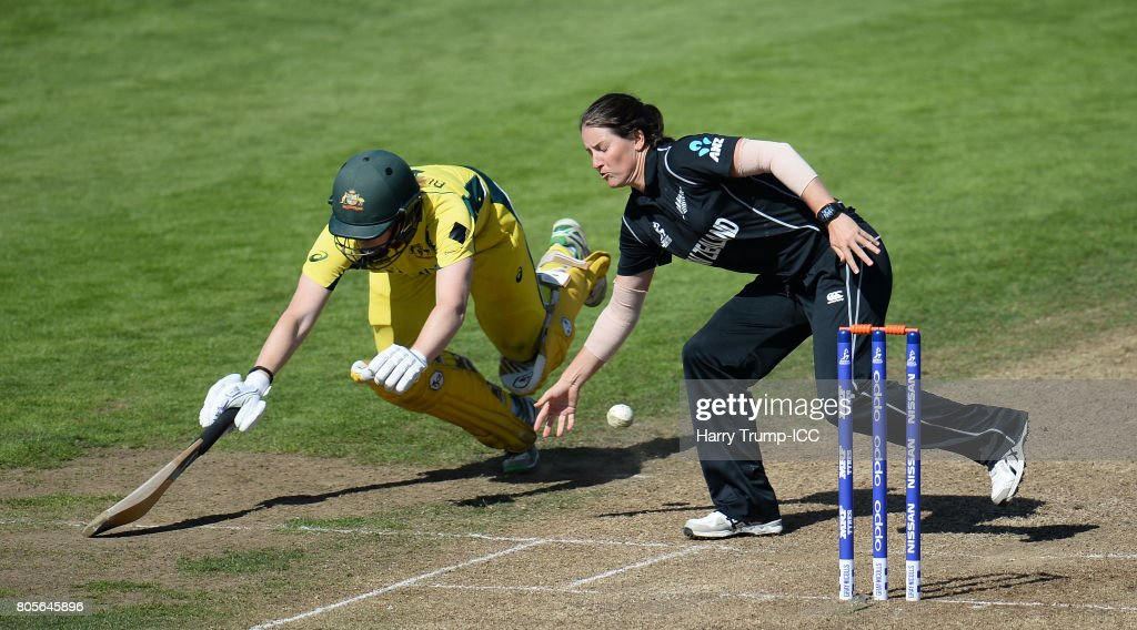Alex Blackwell of Australia dives to make her ground as Holly Huddleston of New Zealand controls the ball during the ICC Women's World Cup 2017 match between Australia and New Zealand at The County Ground on July 2, 2017 in Bristol, England.