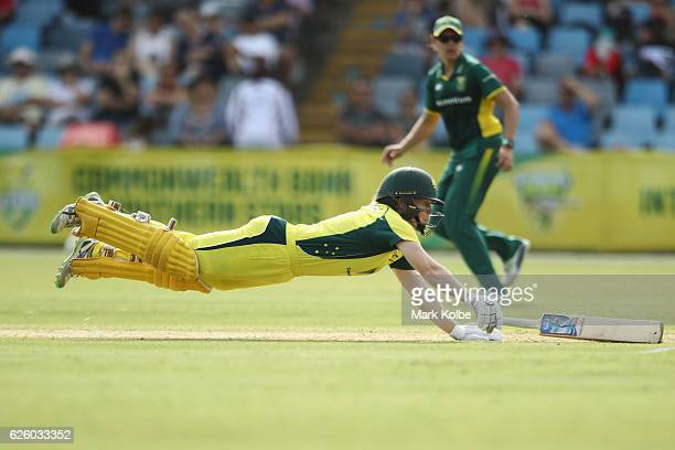 Alex Blackwell of Australia dives to make her ground as she bats during the women's One Day International match between the Australian Southern Stars...