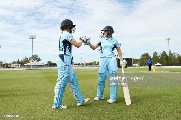 Alex Blackwell of NSW is greeted by Alyssa Healy as she comes out to batduring the WNCL Final match between New South Wales and Western Australia at...