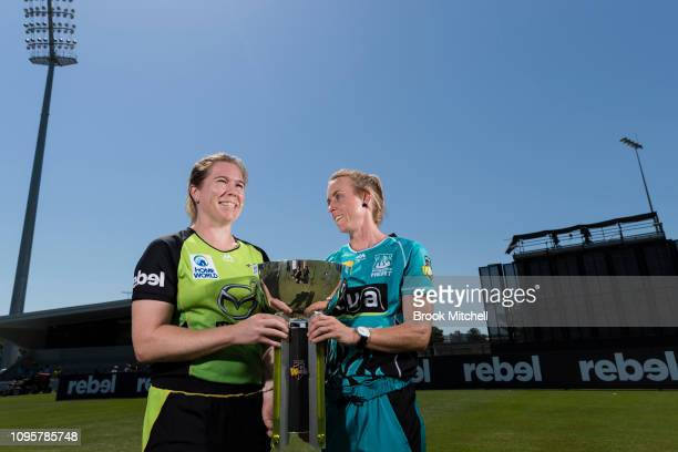 Alex Blackwell of the Sydney Thunder and Kirby Short of the Brisbane Heat pose for photos during the Women's Big Bash League media opportunity at...