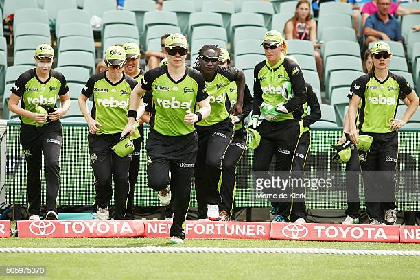 Alex Blackwell of the Sydney Thunder leads her team onto the field during the Women's Big Bash League match between the Sydney Thunder and the Perth...