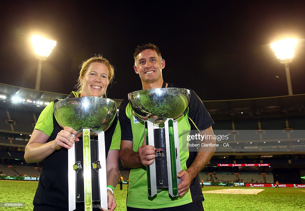 Alex Blackwell of the Sydney Thunder women's team and Mike Hussey of the Sydney Thunder pose with the winners trophies after the Big Bash League final match between Melbourne Stars and the Sydney Thunder at Melbourne Cricket Ground on January 24, 2016 in Melbourne, Australia.