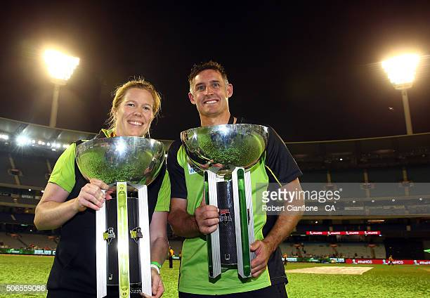 Alex Blackwell of the Sydney Thunder women's team and Mike Hussey of the Sydney Thunder pose with the winners trophies after the Big Bash League...