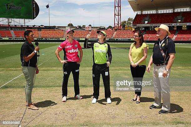Alex Blackwell of the Thunder and Ellyse Perry of the Sixers take part in the coin toss prior to the WBBL match between the Thunder and Sixers at...