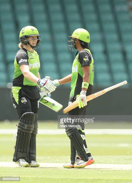 Alex Blackwell of the Thunder and Harmanpreet Kaur of the Thunder celebrate victory in the Women's Big Bash League match between the Sydney Thunder...