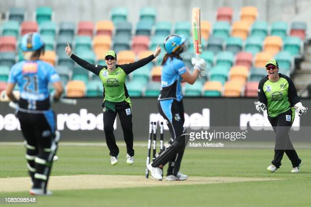 Alex Blackwell of the Thunder and Rachel Priest of the Thunder celebrate the wicket of Tahlia McGrath of the Strikers off the bowling of Lisa...