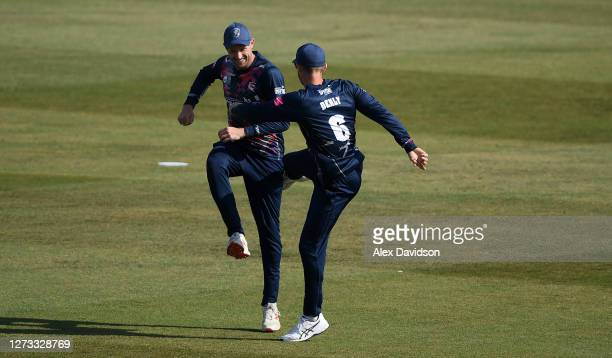 Alex Blake of Kent celebrates the wicket of Dan Lawrence with Joe Denly during the Vitality Blast game between Kent Spitfires and Essex Eagles at The...