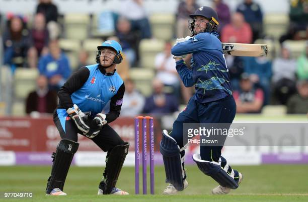 Alex Blake of Kent hits out watched by Ben Cox of Worcestershire Rapids during the Royal London OneDay Cup SemiFinal match between Worcestershire...