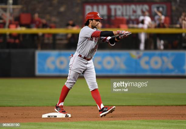 Alex Blandino of the Cincinnati Reds gestures to his dugout after hitting a lead off double during the first inning of a game against the Arizona...