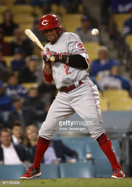 Alex Blandino of the Cincinnati Reds grimaces after being hit by a pitch in the ninth inning during the MLB game against the Los Angeles Dodgers at...