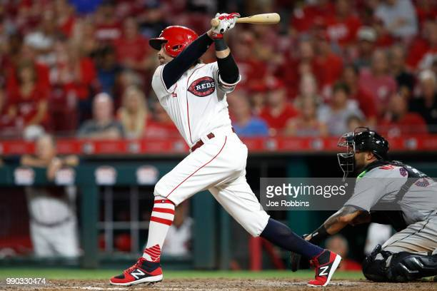 Alex Blandino of the Cincinnati Reds hits a double to right field to drive in two runs to the give his team the lead in the eighth inning against the...