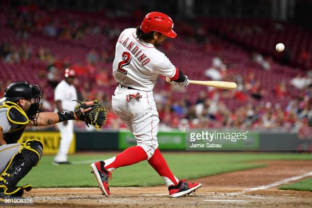 Alex Blandino of the Cincinnati Reds hits an RBI single in the eighth inning against the Pittsburgh Pirates at Great American Ball Park on May 23...
