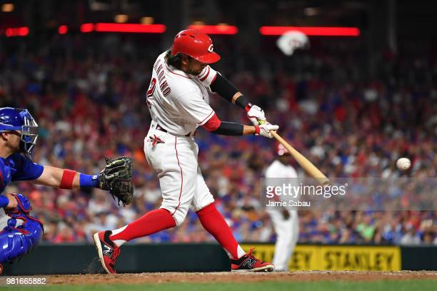 Alex Blandino of the Cincinnati Reds hits an RBI single in the eighth inning against the Chicago Cubs at Great American Ball Park on June 22 2018 in...