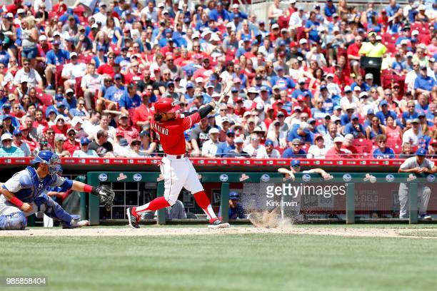 Alex Blandino of the Cincinnati Reds hits the ball during the game against the Chicago Cubs at Great American Ball Park on June 24 2018 in Cincinnati...