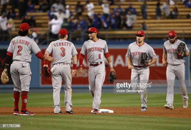Alex Blandino Scooter Gennett Billy Hamilton Adam Duvall and Jose Peraza of the Cincinnati Reds line up to celebrate after their MLB game against the...