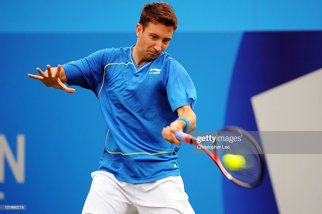 Alex Bogdanovic of Great Britain returns a shot during his first round match against Grigor Dimitrov of Bulgaria during Day 1 of the the AEGON Championships at Queen's Club on June 7, 2010 in London, England.