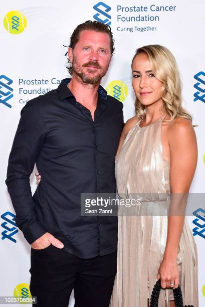 Alex Bogomolov Jr and Luana Bogomolov attend the 14th Annual Prostate Cancer Foundation's Gala In The Hamptons With A Special Performance By John...