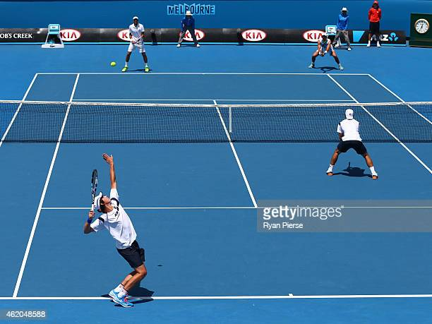 Alex Bolt of Australia and Andrew Whittington of Australia in action in their second round doubles match against Jeremy Chardy of France and Lukasz...