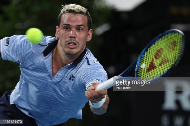 Alex Bolt of Australiaplays a backhand to Stephane Robert of France during day three of the 2020 Adelaide International at Memorial Drive on January...